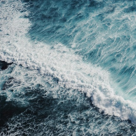 Aerial view of waves in the ocean.